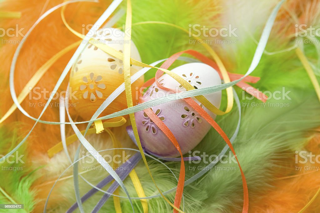 Easter eggs in feathers royalty-free stock photo