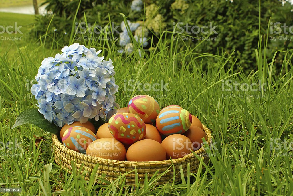 Easter eggs in garden royalty-free stock photo