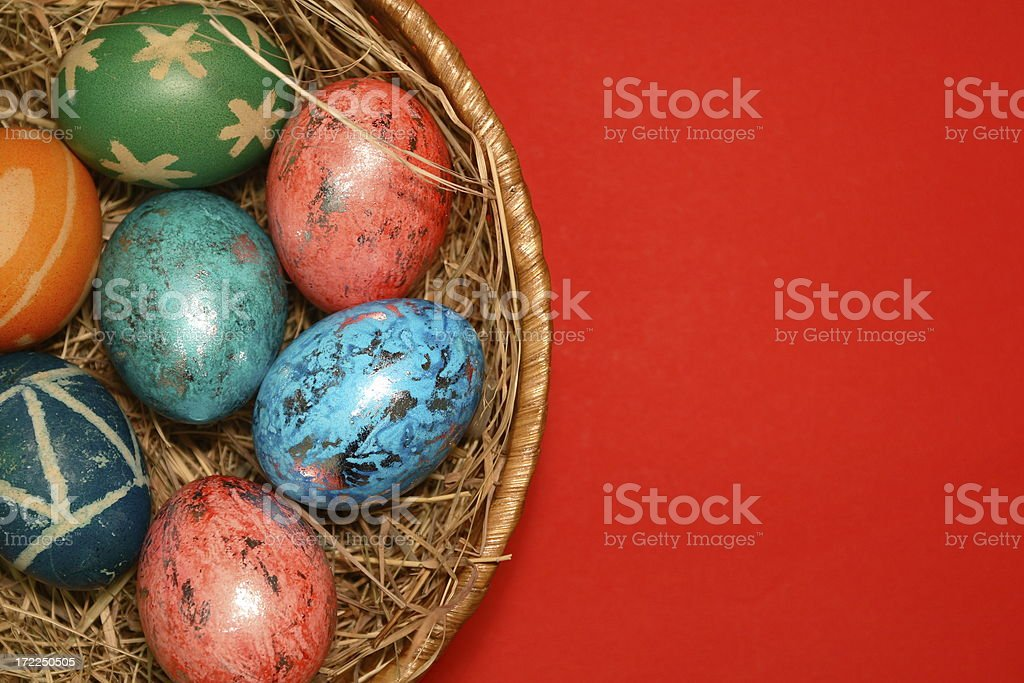 Easter Eggs in Nest on Red royalty-free stock photo
