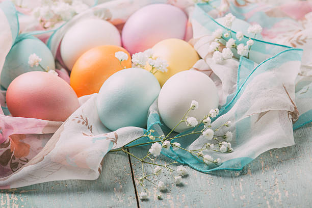 Easter eggs in pastel colors on a wooden table stock photo