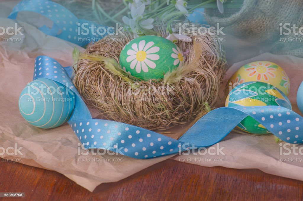 Easter eggs in the nest  and snowdrops royalty-free stock photo