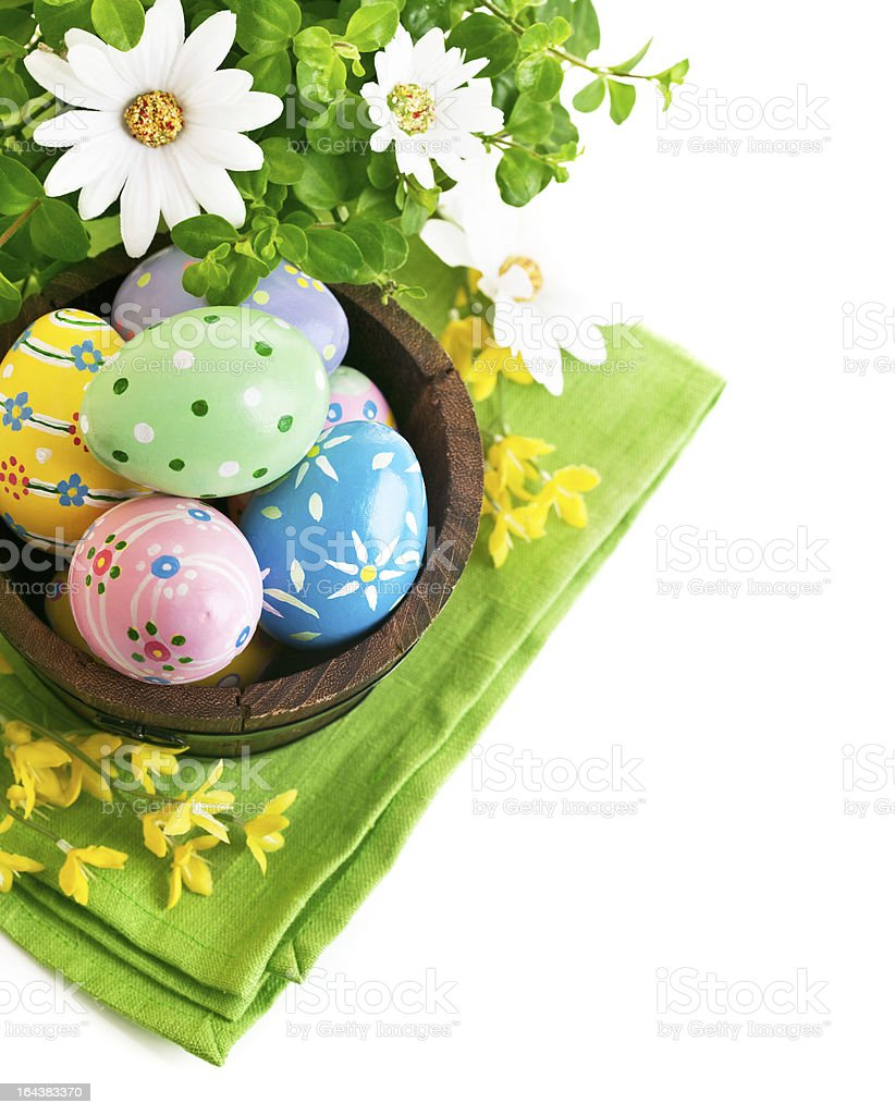 Easter eggs in the pot with flowers royalty-free stock photo