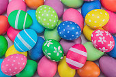 Many colorful decorated painted easter eggs multicolored close up background top view
