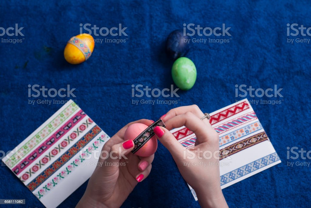 Easter eggs on blue background, royalty-free stock photo