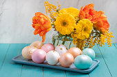 Easter background with easter eggs and tulips.