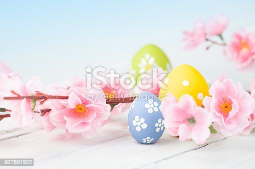 istock Easter eggs on blue wooden background 927891922