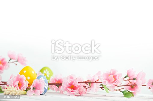 istock Easter eggs on blue wooden background 931011354