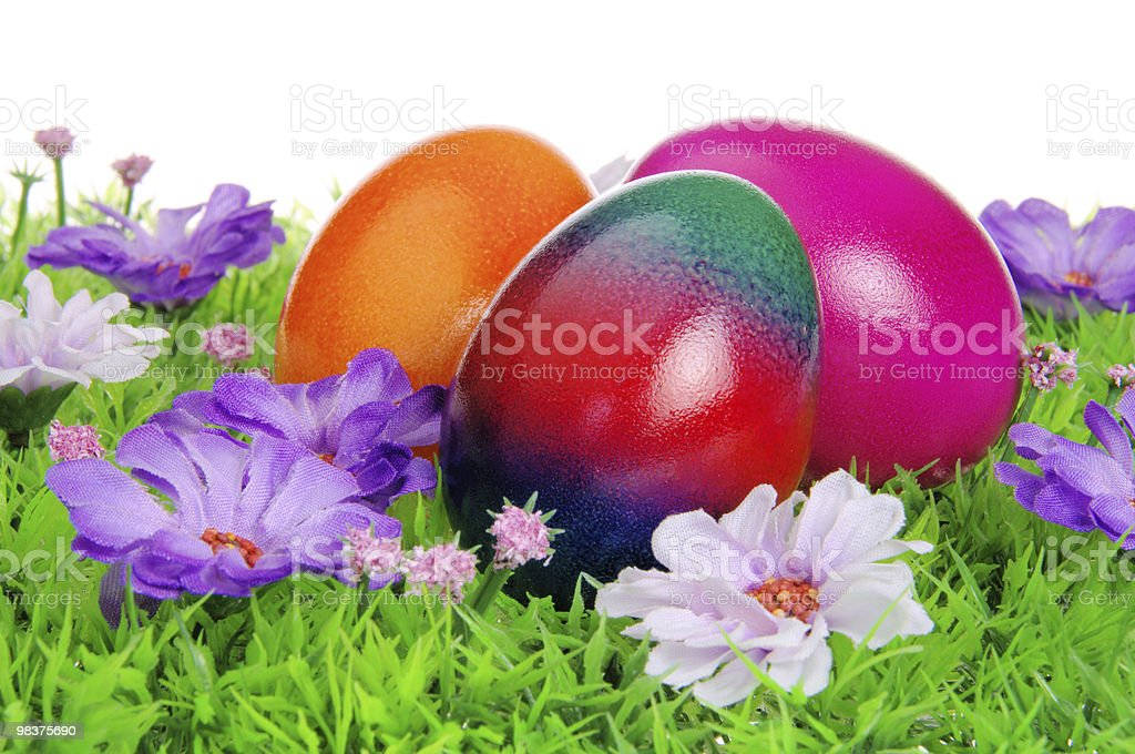 easter eggs on flower meadow royalty-free stock photo