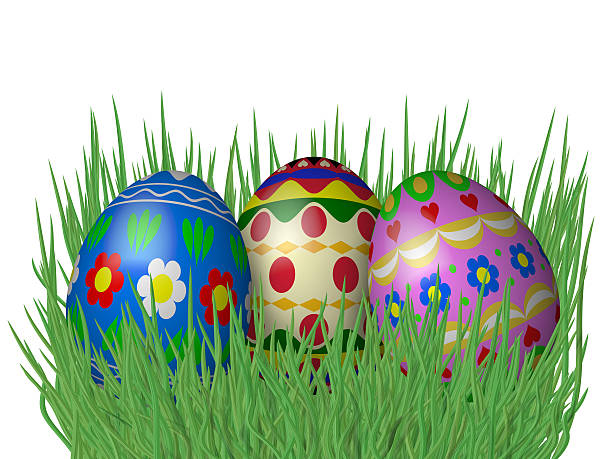 Easter eggs on grass isolated on white background stock photo