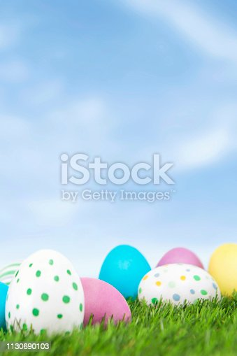 Easter Eggs on green grass with blue sky