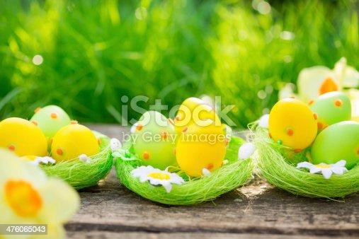 istock Easter eggs on green grass 476065043