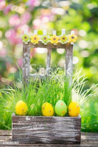 istock Easter eggs on green grass 476065063