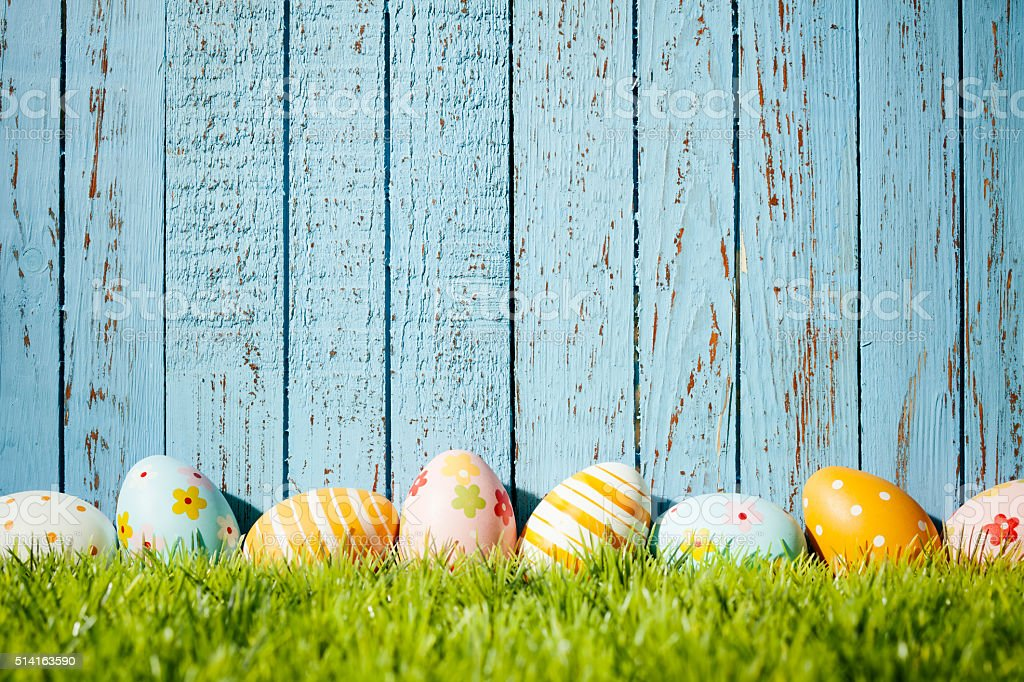 Easter Eggs on Old Blue Wood - Season Background stock photo