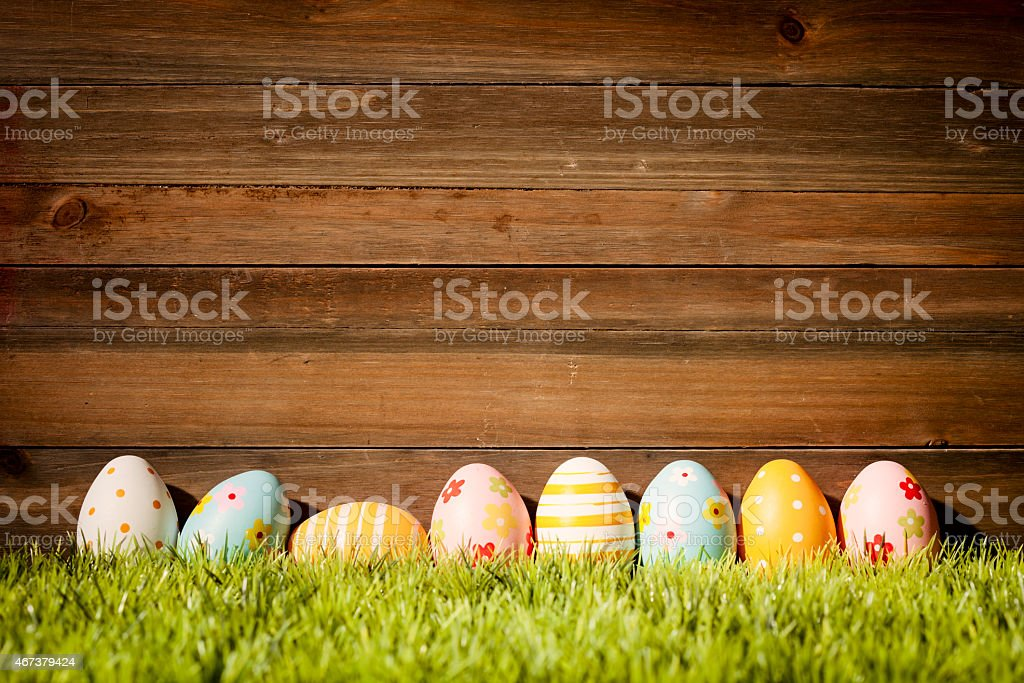 Easter Eggs on Old Wood - Grass Season Background stock photo