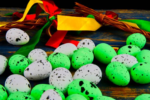 Easter eggs on wooden background. Czech concept. Colour ribbons and Easter theme stock photo