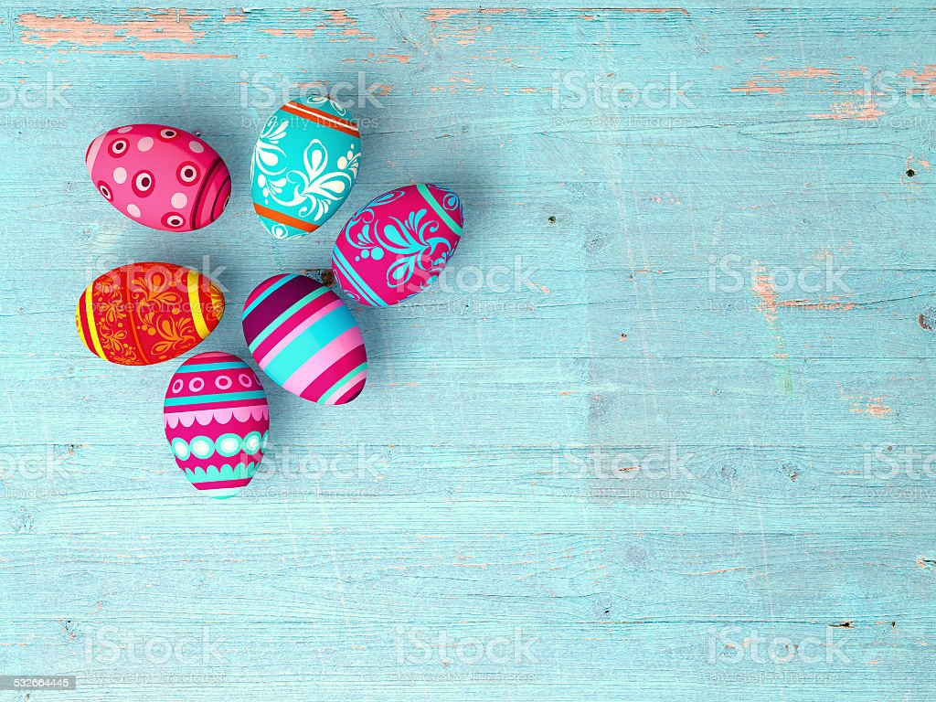 Easter eggs on wooden table background stock photo