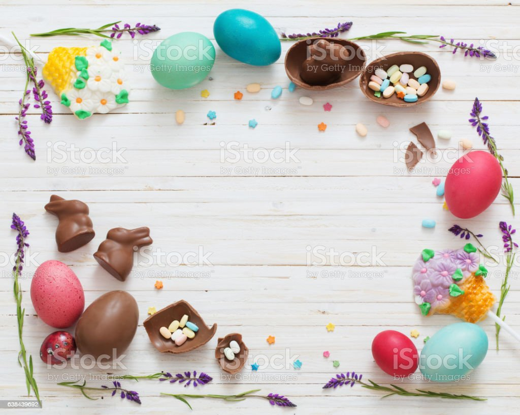 Easter Eggs Over Blue Wooden Background stock photo