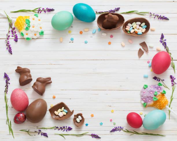 easter eggs over blue wooden background - イースター ストックフォトと画像