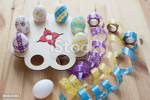 istock Easter eggs painted on a wooden stand, top view 934643464