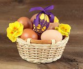 Various eggs in a basket with cowslip