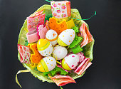 Bunch of colorful easter eggs in a basket