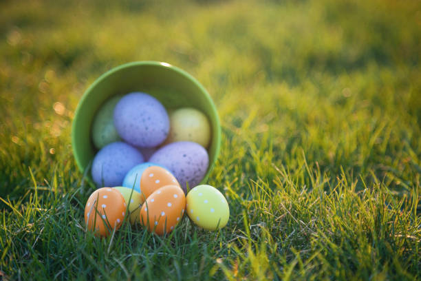 Easter eggs rolling out of bucket stock photo
