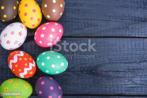 Easter eggs top view on black wooden background and have copy space for use