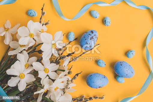 istock Easter eggs willow branches and white daffodils 899688180