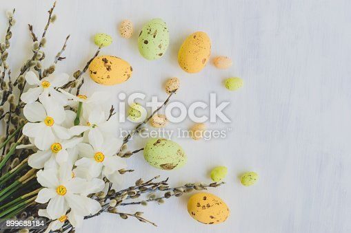 istock Easter eggs willow branches and white daffodils 899688184