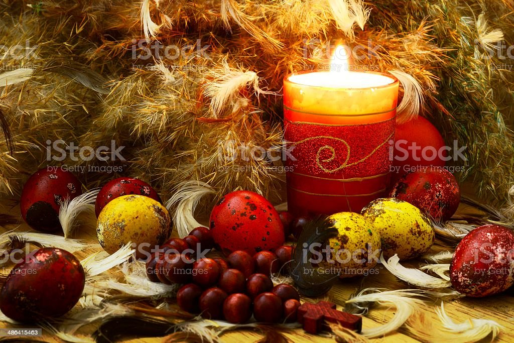 Easter eggs with candle and down royalty-free stock photo