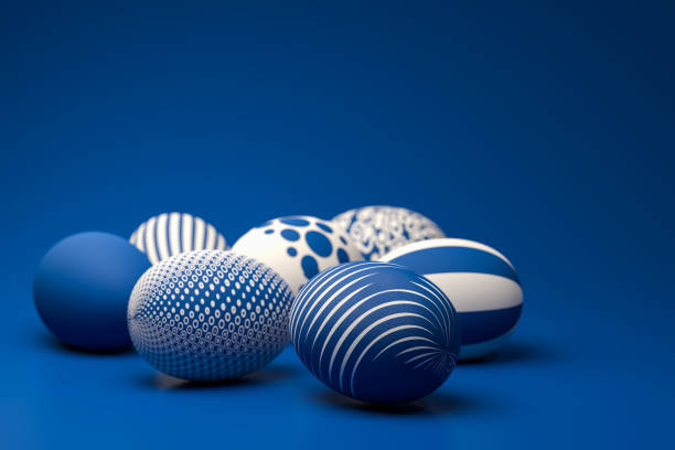 Easter Eggs with different textures in classic blue on a seamless blue background. Selective focus on foreground. stock photo