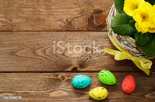 istock Easter eggs with spring yellow flower on old wooden background. Easter composition with  copyspace for text. Happy Easter Day concept, greeting card. Springtime. Spring mood. 1347836279