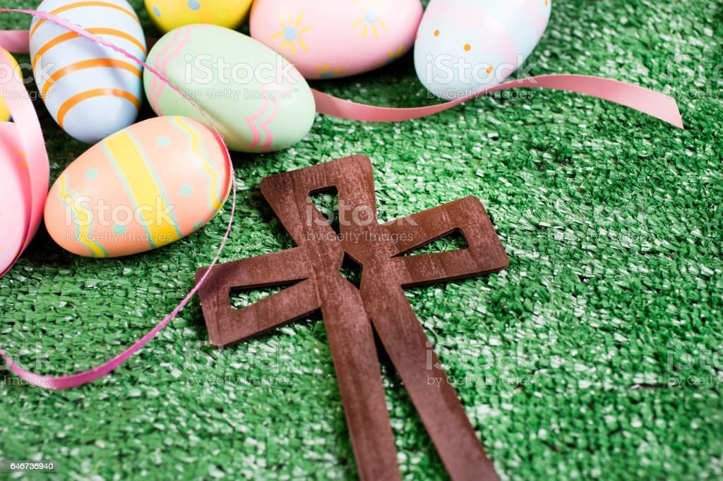 Easter Eggs With Wooden Cross On Grass Royalty Free Stock Photo