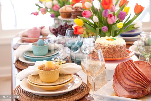 istock Easter Elegant Place Setting Dining Table with Vase of Tulips 507172728