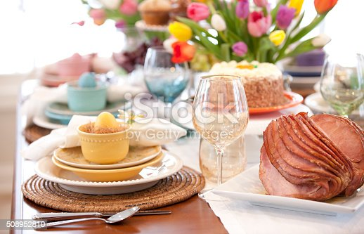 istock Easter Elegant Place Setting Dining Table with Vase of Tulips 508952810