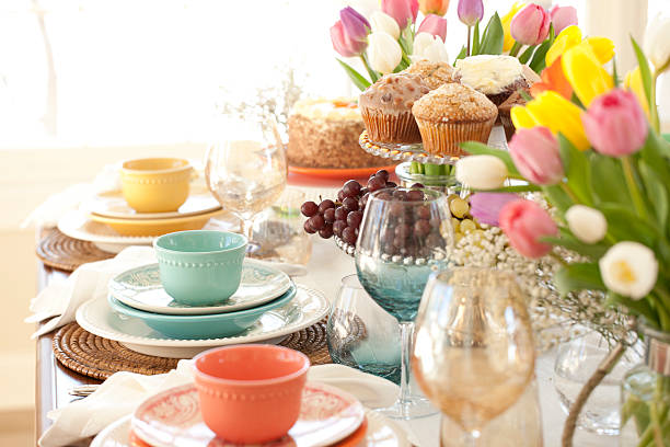 easter elegant place setting dining table with vase of tulips - easter brunch stock photos and pictures