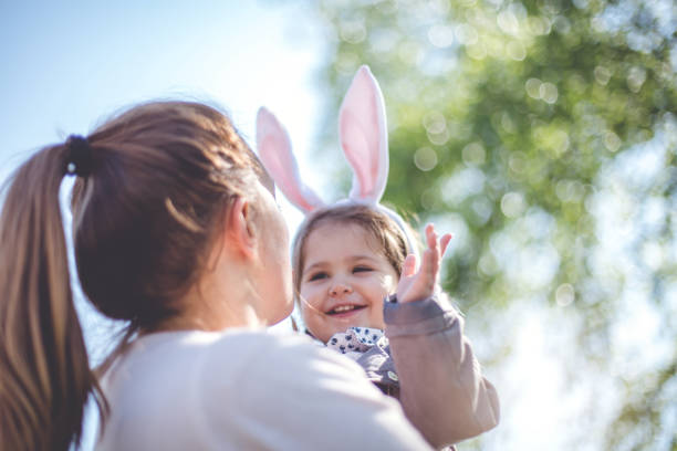 easter family time - easter stock pictures, royalty-free photos & images