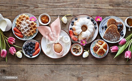 1131445181 istock photo Easter festive dessert table 1129886604