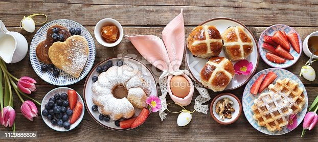 1131445181 istock photo Easter festive dessert table 1129886605