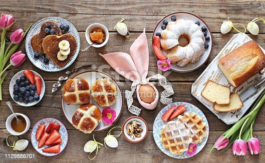 1131445181 istock photo Easter festive dessert table 1129886701