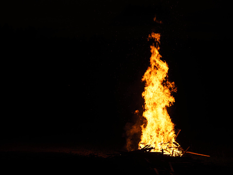 Easter fire. Large orange flame isolated on a black background. Brightly, heat, light,  big bonfire. Awesome Easter