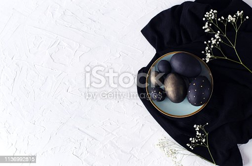istock Easter flat lay with black eggs on a white background. 1136992815