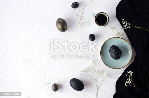istock Easter flat lay with black eggs on a white background. 1139684331