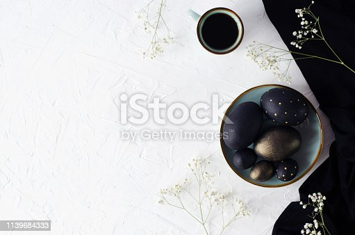 istock Easter flat lay with black eggs on a white background. 1139684333