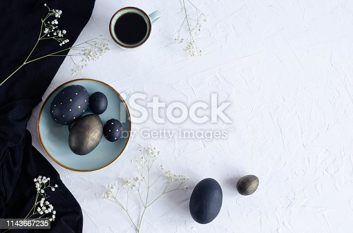 istock Easter flat lay with black eggs on a white background. 1143667235