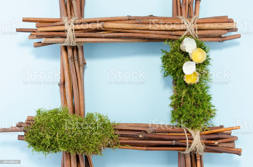 Easter frame with two raw quail eggs and empty blue stock photo