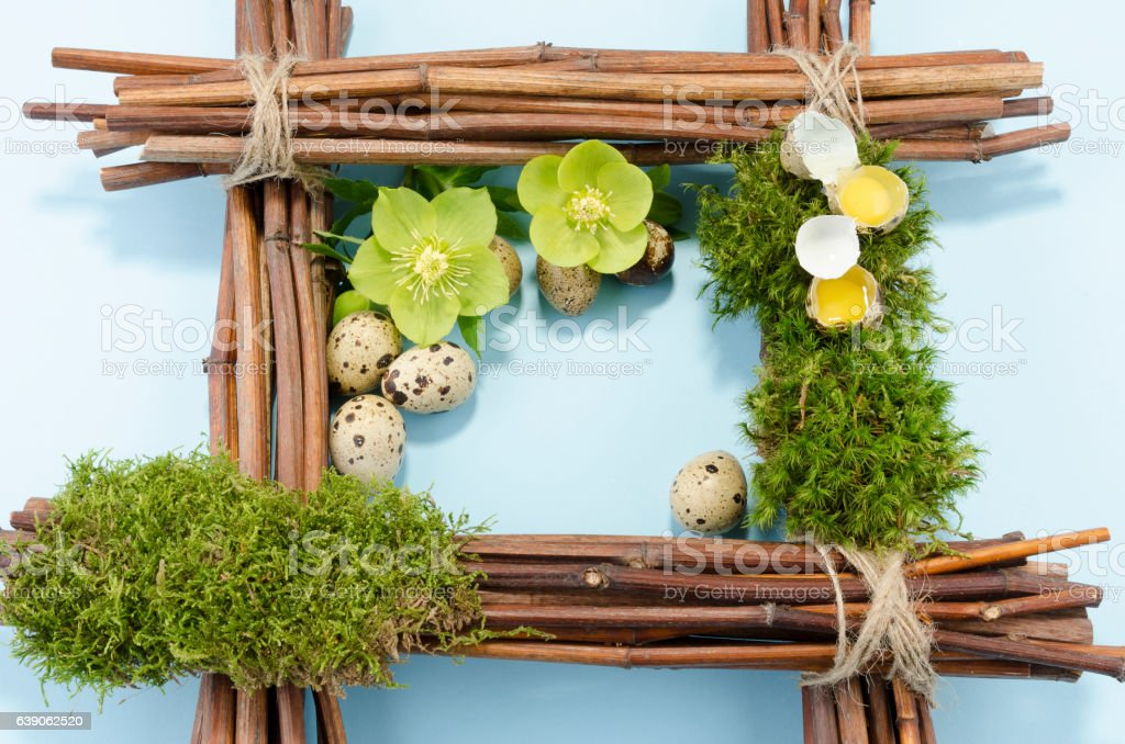 Easter frame with two raw quail eggs up and many stock photo