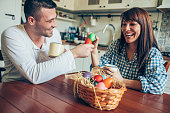 Young Couple Breaking Easter Eggs