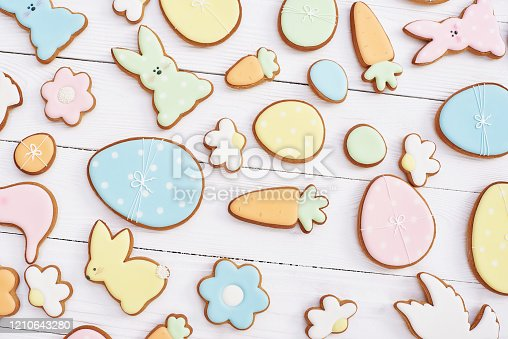 istock Easter greeting card with gingerbread cookies. Easter spring decorative composition with homemade easter cookies in shape of funny rabbit and eggs 1210643280