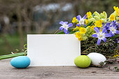 Spring flowers with Easter eggs and card